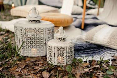 Two metal lanterns with flameless candles