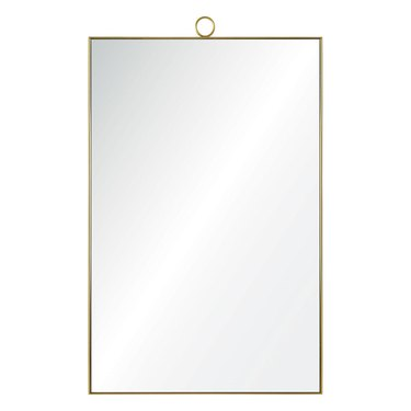 Oversized rectangular mirror with thin brass border and small installation loop at the top