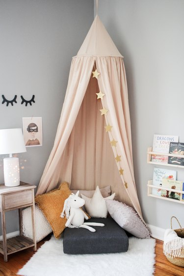 Kids reading nook with hanging canopy tent