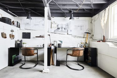 industrial basement office with leather chairs and white walls