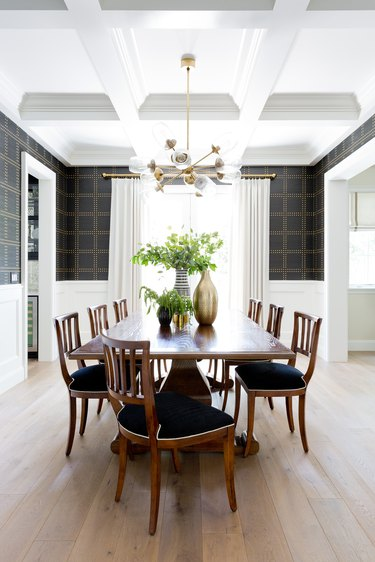 traditional dining room lighting hanging from coffered ceiling