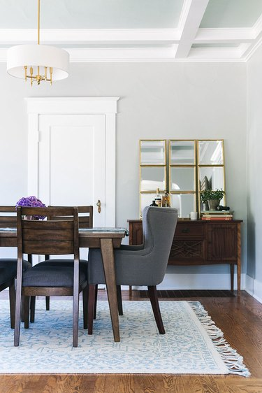 Craftsman dining room with brass and white traditional dining room lighting