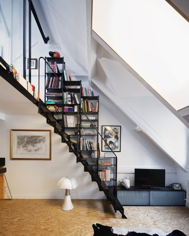 floating stairs with built-in bookcase