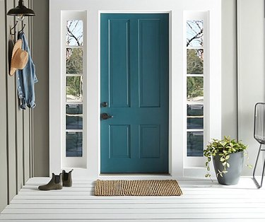 teal color front door with white trim and khaki walls