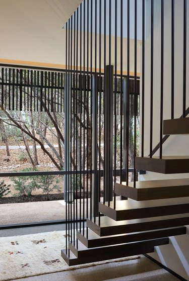floating stairs with steel spindle rails