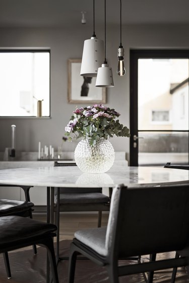 industrial style dining room of Buster + Punch founder Massimo Minale