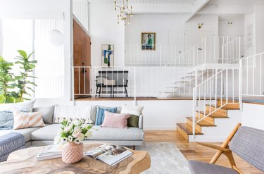 white living room with floating stairs