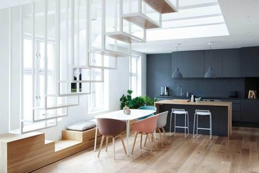 white floating stairs with dining room below
