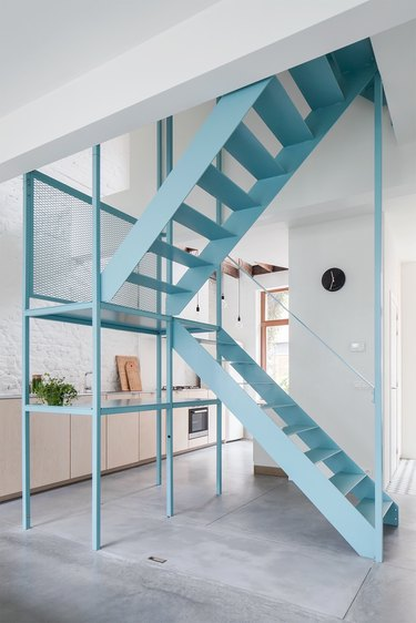 blue floating stairs in minimalist home