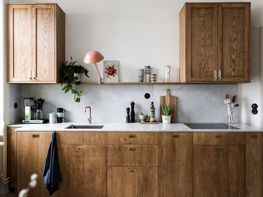 Modern kitchen lighting idea with wood cabinets