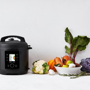 CHEF iQ smart cooker with raw veggies on table