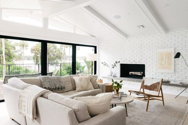 living room with white brick wall