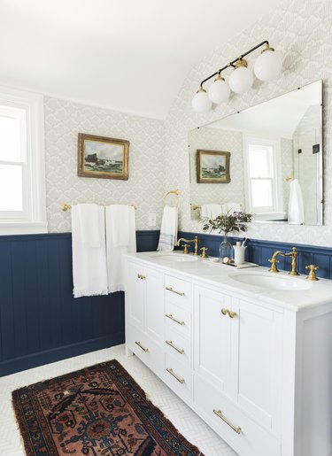 White traditional bathroom vanity idea with blue wainscoting and double sinks