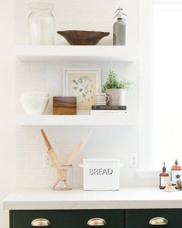 White farmhouse kitchen idea with green cabinets