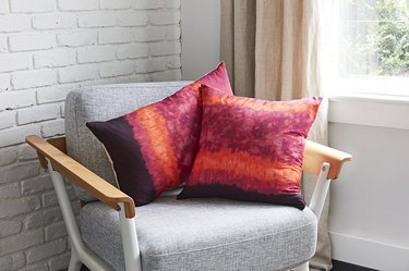 gray char with two pink dyed pillows