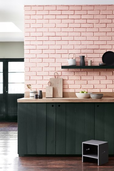 pink brick wall in kitchen