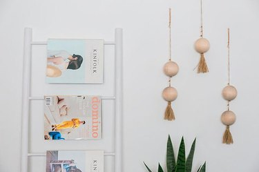 cluster of three wooden bead wall hangings