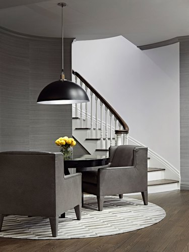 basement furniture with gray chairs and small table