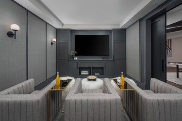 basement furniture with tv and white ottomans