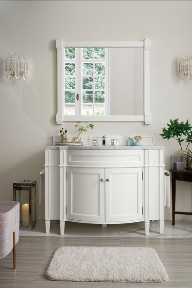 traditional bathroom vanity idea with curved front