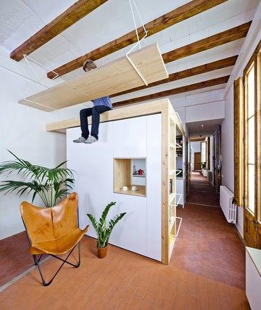 floating desk suspended above living area and kitchen