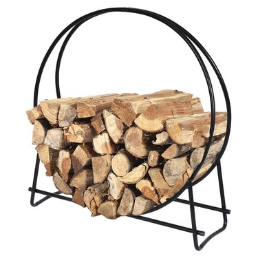 Black metal minimal firewood storage with circular frame
