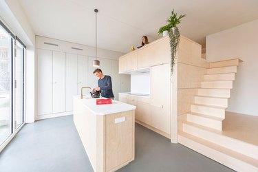 plywood kitchen in open-concept loft design