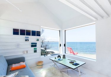 beachside cabin with ocean views from all-white living room