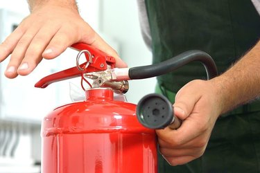 Using s fire extinguisher.