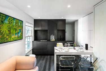 small apartment with modular storage and fold-out dining table