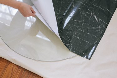 Peeling backing off contact paper