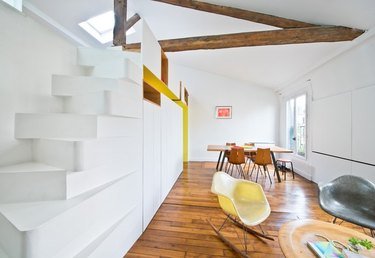 open living and dining room with staircase leading up to loft area