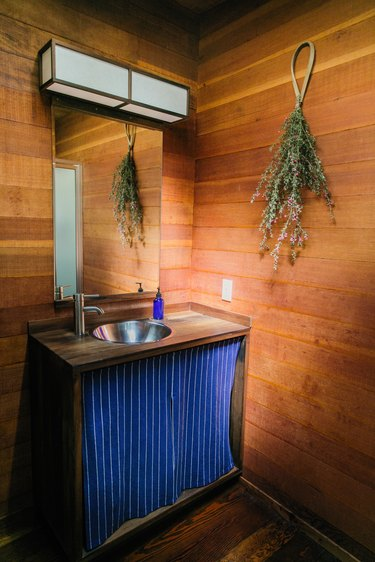 Bathroom with stainless steel bathroom sink photographed by Describe the Fauna