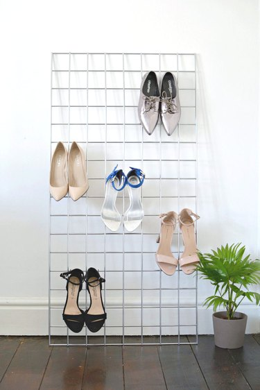 Shoes on a metal grid