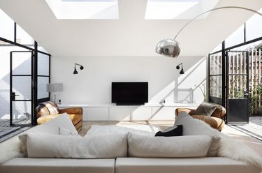 symmetrical living room design with skylights
