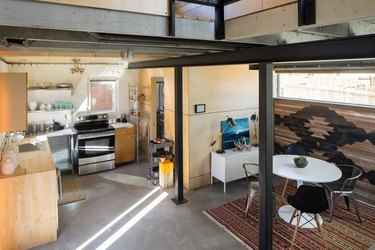 open-beamed kitchen and dining with modern-industrial decor