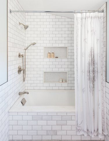 Budget bathroom remodel with subway tile in shower