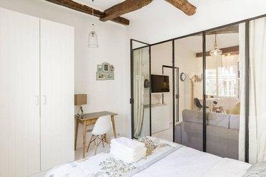 bedroom with transparent screen door enclosure