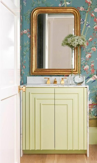 art deco decorating on a budget on a bathroom cabinet below a mirror