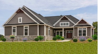 exterior of craftsman style ranch home with white trim