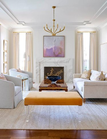 art deco decorating on a budget in living room with molding and fireplace