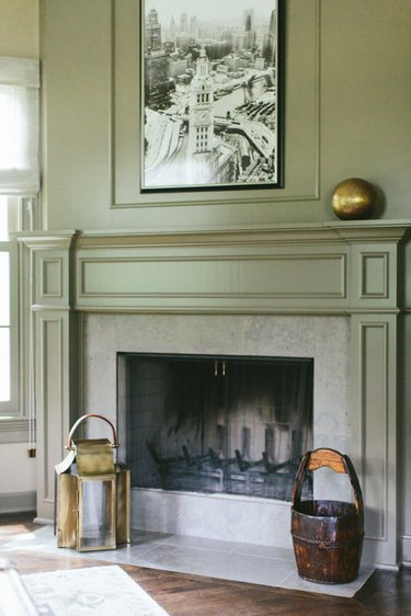 traditional mantel decor with brass gloce and crown molding