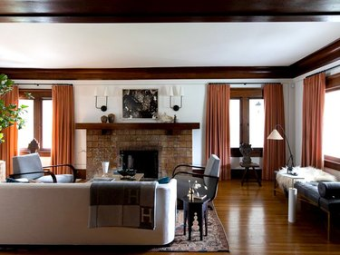 traditional mantel decor with sconces in living room