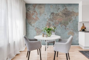 World map wallpaper with table and chairs