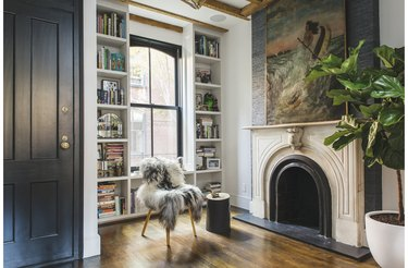 traditional mantel decor with large painting and black door