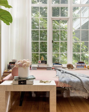 daybed in the living room idea with modern pink daybed against a floor lenghth window with white curtains