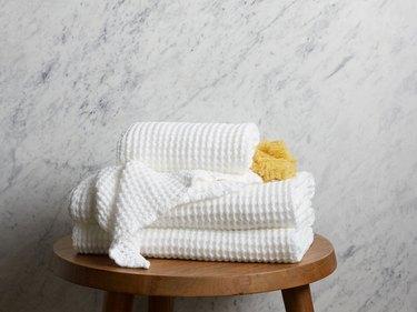 minimalist bathroom toiletries with waffle bath towels