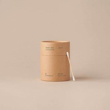 minimalist bathroom toiletries with bamboo cotton swabs