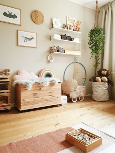 beige color kid bedroom with wooden furniture and terra cotta rug