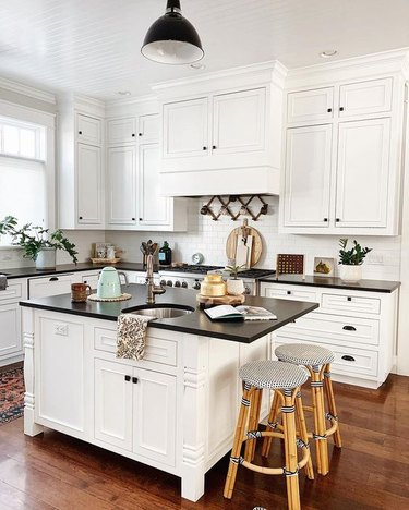 Kitchen lighting idea in white kitchen with black industrial semi-flush mount fixture